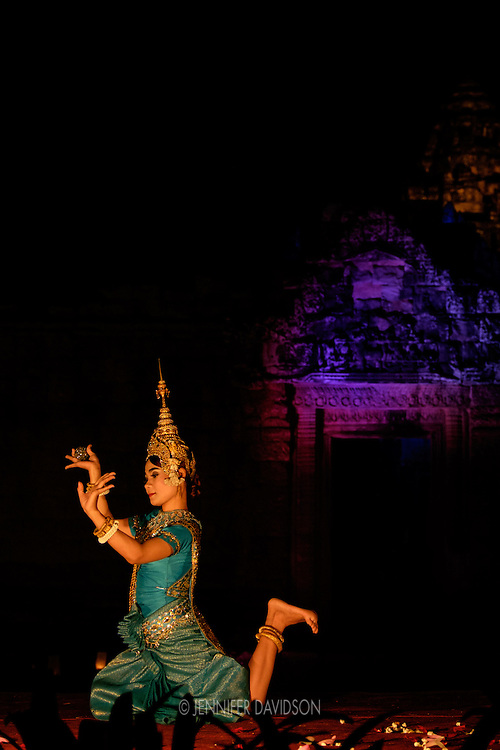An Apsara dancer performs at the Banteay Samre temple at night.