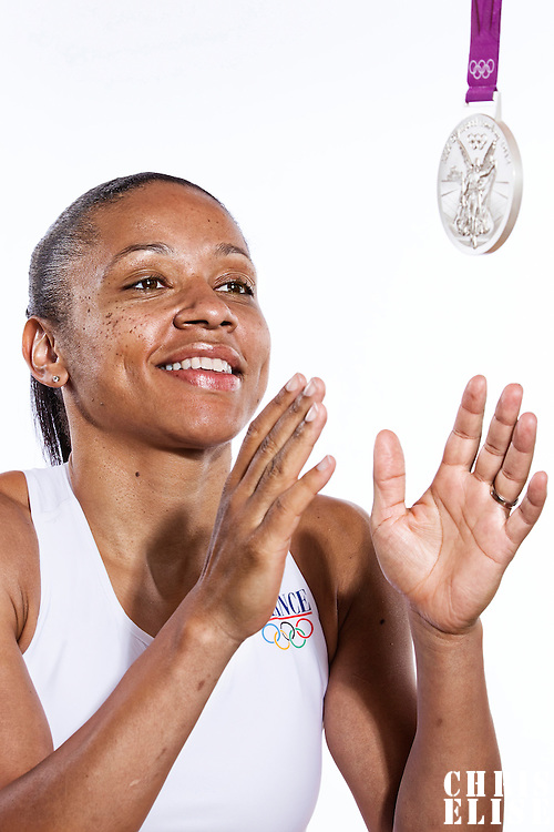 14 August 2012:  Olympic Silver Medalist Edwige Lawson-Wade (Team France Basketball) poses with her silver medal, at the Hotel Concorde Lafayette, in Paris, France.
