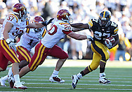 September 11 2010: Iowa Hawkeyes running back Jewel Hampton (27) stiff arms Iowa State Cyclones linebacker Jake Knott (20) on a run during the second half of the NCAA football game between the Iowa State Cyclones and the Iowa Hawkeyes at Kinnick Stadium in Iowa City, Iowa on Saturday September 11, 2010. Iowa defeated Iowa State 35-7.