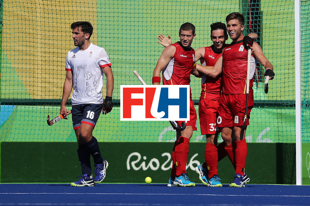 RIO DE JANEIRO, BRAZIL - AUGUST 06:  John-John Dohmen #7, Cedric Charlier #10, and John-John Dohmen #7 of Belgium react to a goal as Adam Dixon #16 of Great Britain looks on during a Pool A match between Belgium and Great Britain on Day 1 of the Rio 2016 Olympic Games at the Olympic Hockey Centre on August 6, 2016 in Rio de Janeiro, Brazil.  (Photo by Sean M. Haffey/Getty Images)