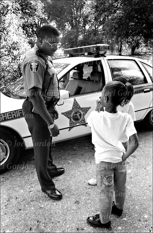 African American police officer interaction with children in the community, Putnam County Sheriff's Office, FL