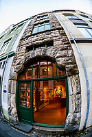 The narrowest building in Alesund, Norway on Kongens gate (a pedestrian street) contains an art gallery. The town is famous for its art nouveau (Jugendstil) architecture. The  town was rebuilt after a fire in 1904. Alesund is in the heart of Fjord Country, at the entrance to Geirangerfjord on Norway's west coast.