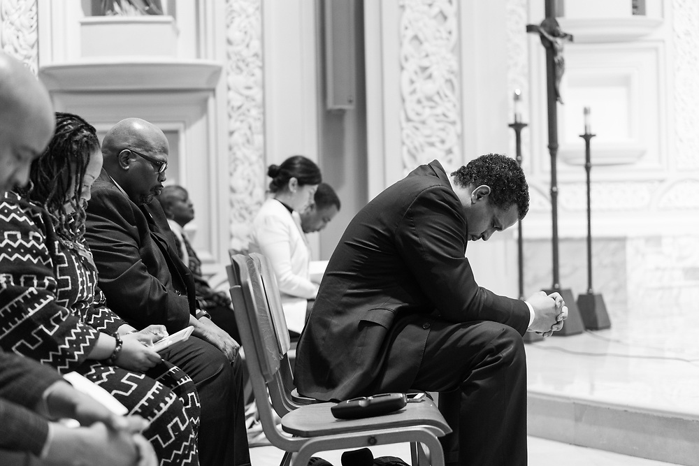 Troy LaRaviere, Chicago mayoral candidate and head of Chicago's Principal Association joins in an opening prayer before giving a speech at a Martin Luther King day Faith In Action Assembly at Old St. Patrick's Church in Chicago on January 15, 2018.