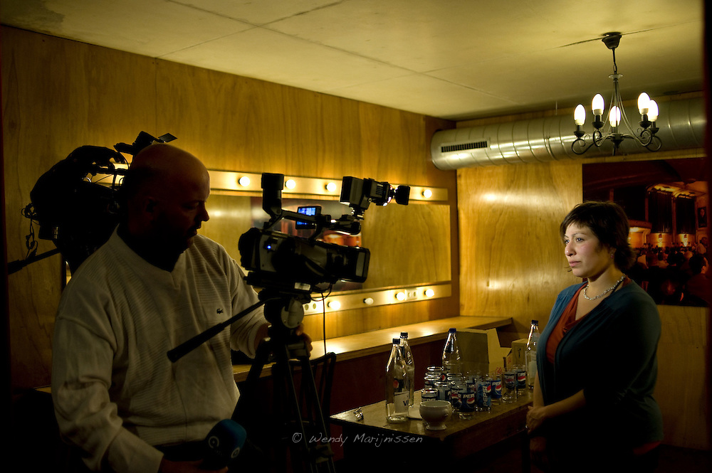 Meyrem Almaci gives an interview to local Antwerp tv station ATV following a debate at the 'Feest van de sociale politiek' in the run-up to the local elections in Antwerpen. Belgium, 2012