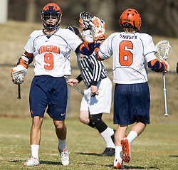 Virginia Cavaliers A Danny Glading (9) congratulates Virginia Cavaliers A Steele Stanwick (6) after a UVA goal.  The #2 ranked Virginia Cavaliers defeated the Drexel Dragons 13-7 at the University of Virginia's Klockner Stadium in Charlottesville, VA on February 14, 2009.