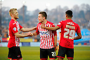 Exeter City's David Wheeler celebrates scoring his goal to give the home side a 2-1 lead with Exeter City's Jayden Stockley and Exeter City's Ollie Watkins during the Sky Bet League 2 match between Exeter City and Carlisle United at St James' Park, Exeter, England on 12 March 2016. Photo by Graham Hunt.
