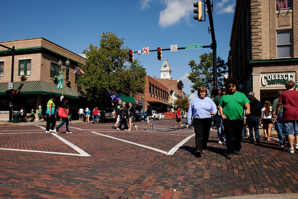 Court Street in downtown Athens, Ohio is busy with Ohio University students and their parents during Parent's Weekend on September, 22, 2012. .Photo by Chris Franz