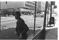 Street scene with man with hat in Los Angeles. Black & White, 1980.