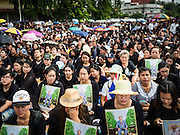 14 OCTOBER 2016 - BANGKOK, THAILAND: People wait on Rajadamnoen Avenue in Bangkok for the King's body to be brought to the Grand Palace. King Bhumibol Adulyadej died Oct. 13, 2016. He was 88. His death comes after a period of failing health. With the king's death, the world's longest-reigning monarch is Queen Elizabeth II, who ascended to the British throne in 1952. Bhumibol Adulyadej, was born in Cambridge, MA, on 5 December 1927. He was the ninth monarch of Thailand from the Chakri Dynasty and is known as Rama IX. He became King on June 9, 1946 and served as King of Thailand for 70 years, 126 days. He was, at the time of his death, the world's longest-serving head of state and the longest-reigning monarch in Thai history.     PHOTO BY JACK KURTZ