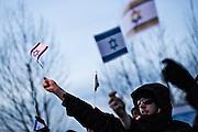 Magdeburg | 18 Jan 2014<br /> <br /> ACHTUNG BESONDERE HONORARKONDITIONEN!<br /> <br /> Am Samstag (19.01.2014) marschierten etwa 1000 Neonazis bei einem &quot;Gedenkmarsch&quot; durch Magdeburg, um der Bombardierungen der Stadt im 2. Weltkrieg zu &quot;gedenken&quot;.<br /> Hier: Anti-Nazi-Demonstranten mit kleinen Israel-Fahnen.<br /> <br /> &copy;peter-juelich.com<br /> <br /> [No Model Release | No Property Release]