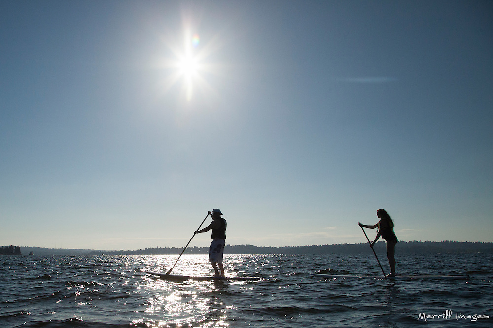United States, Washington, Kirkland,  two people on stand up paddleboards on Lake Washington