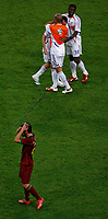 Photo: Glyn Thomas.<br />Portugal v France. Semi Final, FIFA World Cup 2006. 05/07/2006.<br /> Portugal's Heldar Postiga (bottom) holds his head in his hands as France celebrate.