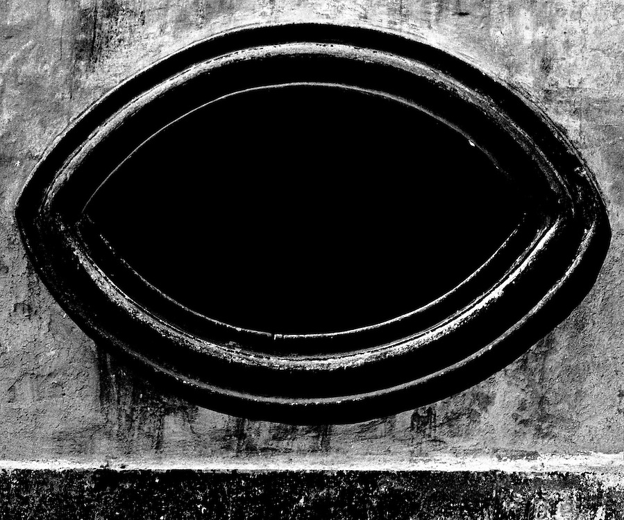 Eye window in Colonial church in Pueblo, Mexico.  Black and white photo taken with Nikon F in 35 mm format.