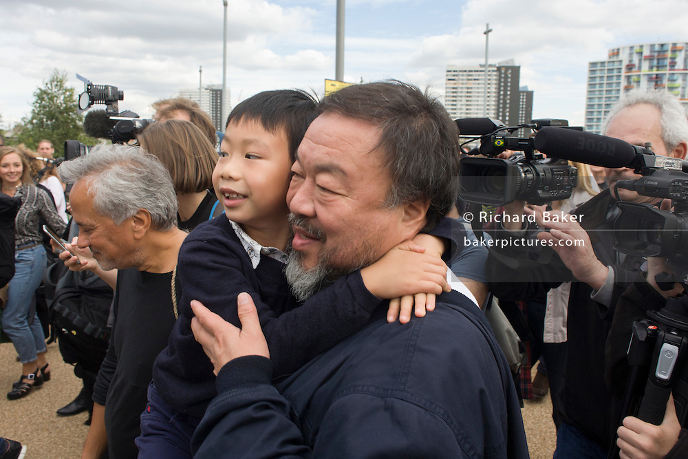 "Chinese artist Ai Weiwei and his son. He and Anish Kapoor walk with a following entourage of supporters and media through central London - from the Royal Academy in Piccadilly to the former Olympic Park Stratford, eight-miles to show solidarity with refugees around the world. ""It is an act of solidarity and minimal action – we like that spirit,"" said Kapoor. Ai, who has a show at the Royal Academy opening to the public on Saturday, said ""We are all refugees somehow, somewhere and at some moment."""