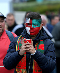 A supporter with half his face painted with an England flag and the other half a Portugal flag arrives at Wembley - Mandatory by-line: Robbie Stephenson/JMP - 02/06/2016 - FOOTBALL - Wembley Stadium - London, United Kingdom - England v Portugal - International Friendly