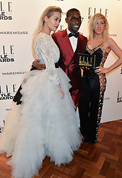 Left to right, RITA ORA, TINIE TEMPAH and ELLIE GOULDING at the 17th Elle Style Awards 2014 in association with Warehouse held at One Embankment, 8 Victoria Embankment, London on 18th February 2014.