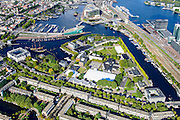 Nederland, Noord-Holland, Amsterdam, 27-09-2015; Overzicht Marineterrein en omgeving, inclusief Scheepvaartmuseum. Kattenburg en Oosterdok met de IJtunnel en museum Nemo. Oosterdokseiland (ODE), Centraal Station, water van het IJ. <br /> View on Navy area (center) and the National Maritime Museum (left, white building). Museum Nemo (copper green), central station, newly constructed buildings. <br /> <br /> luchtfoto (toeslag op standard tarieven);<br /> aerial photo (additional fee required);<br /> copyright foto/photo Siebe Swart