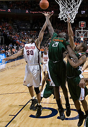 Virginia Cavaliers forward Adrian Joseph (30) and Miami Hurricanes forward Dwayne Collins (21) battle for a rebound.  The University of Virginia Cavaliers defeated the Miami Hurricanes Men's Basketball Team 81-70 at the John Paul Jones Arena in Charlottesville, VA on February 3, 2007.