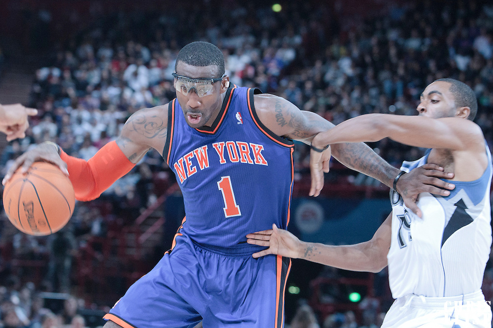 06 October 2010: New York Knicks forward Amare Stoudemire #1 drives past Minnesota Timberwolves guard Wayne Ellington #19 during the Minnesota Timberwolves 106-100 victory over the New York Knicks, during 2010 NBA Europe Live, at the POPB Arena in Paris, France.