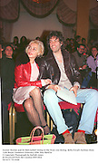 Jeanne Marine and Sir Bob Geldof sitting in the front row during  Bella Freud's fashion show. Cafe Royal. London23 February 1998. film 9849f34<br />