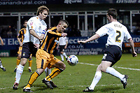 Photo: Leigh Quinnell.<br /> Luton Town v Hull City. Coca Cola Championship. 13/03/2007. Hulls Dean Windass gets between Lutons Markus Heikkinen and Kevin Foley.