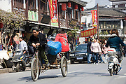 Tricycle on busy street in Old Shanghai, China