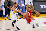 Golden State Warriors guard Stephen Curry (30) defends Houston Rockets guard Eric Gordon (10) at Oracle Arena in Oakland, Calif., on October 17, 2017. (Stan Olszewski/Special to S.F. Examiner)