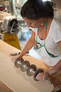 Jamestown, RI - 7 May 2007. Dorianna Carella, co-owner of The Village Hearth Bakery and Cafe, cutting pastry.