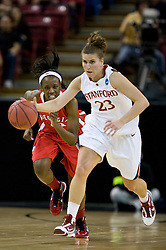March 27, 2010; Sacramento, CA, USA; Stanford Cardinal guard Jeanette Pohlen (23) dribbles past Georgia Bulldogs guard Meredith Mitchell (11) during the first half in the semifinals of the Sacramental regional in the 2010 NCAA womens basketball tournament at ARCO Arena.  Stanford defeated Georgia 73-36.