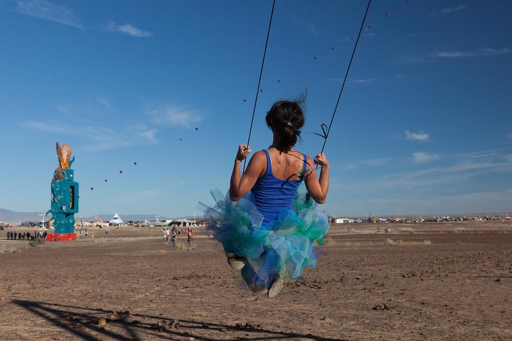 Girl on a swing at AfrikaBurn 2014, Tankwa Karoo desert, South Africa