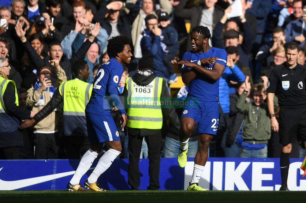 Chelsea's Michy Batshuayi (right) celebrates scoring his side's fourth goal of the game with teammate Willian during the Premier League match at Stamford Bridge, London.