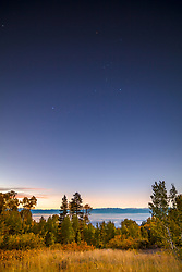 """Orion Over Lake Tahoe 1"" - Photograph of the constellation Orion above an Aspen grove and Lake Tahoe, shot just before sunrise."