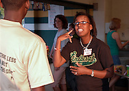 11 SEPT. 2009 -- ST. LOUIS -- Lindbergh High School parent Rasheedah Krus (center, CQ) talks with her son Dominic Tillman (CQ) while working at the Lindbergh concession stand during the Flyers game against  Oakville High School Friday, Sept. 11, 2009. Krus' daughter Daniele Tillman is a cheerleader for Lindbergh, and son Dominic runs cross country. Photo © copyright 2009 by Sid Hastings.