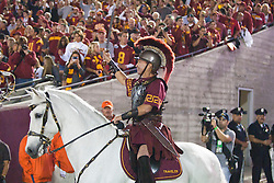 September 11, 2010; Los Angeles, CA, USA;  The Southern California Trojans mascot enters the field on horseback before the game against the Virginia Cavaliers at the Los Angeles Memorial Coliseum. USC defeated Virginia 17-14.