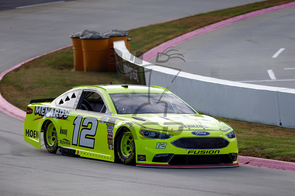 Ryan Blaney (12) races through turn three to practice  for the First Data 500 at Martinsville Speedway in Martinsville, Virginia.