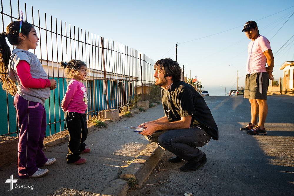 The Rev. Juan Pablo Lanterna of the Confessional Lutheran Church of Chile greets children on Monday, April 21, 2014, in the historic port city of Valparaíso, Chile. A fire in April killed 15 people, destroyed about 3000 homes, and left approximately 15,000 people homeless.  LCMS Communications/Erik M. Lunsford