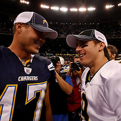 August 27, 2010; New Orleans, LA, USA; New Orleans Saints quarterback Drew Brees (9) meets with San Diego Chargers quarterback Philip Rivers (17) following a preseason game at the Louisiana Superdome. The New Orleans Saints defeated the San Diego Chargers 36-21. Mandatory Credit: Derick E. Hingle