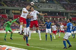 October 14, 2018 - Chorzow, Poland - Kamil Glik and Jan Bednarek of Poland jump for the ball during the UEFA Nations League A match between Poland and Italy at Silesian Stadium in Chorzow, Poland on October 14, 2018  (Credit Image: © Andrew Surma/NurPhoto via ZUMA Press)