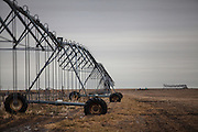 A center pivot irrigation system sits on the Oelke family farm outside of Hoxie, Kan., on Friday, Oct. 12, 2012. As historically dry conditions continue, farmers from South Dakota to the Texas panhandle rely on the Ogallala Aquifer, the largest underground aquifer in the United States, to irrigate crops. After decades of use, the falling water level ? accelerated by historic drought conditions over the last two years ? is putting pressure on farmers to ease usage or risk becoming the last generation to grow crops on the land. Farmers like Mitchell Baalman and Brett Oelke (not pictured) are part of a farming community in in Sheridan County, Kansas, an agricultural hub in western Kansas, who have agreed to cut back on water use for crop irrigation so that their children and future generations can continue to farm and sustain themselves on the High Plains.