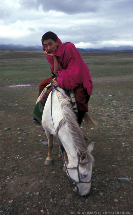 Oulsal. Tibetans rent horses for horse-riding at the grasslands..LAMBRANG MONASTERY IN XIAHE - CHINA.copyright: Androniki Christodoulou.