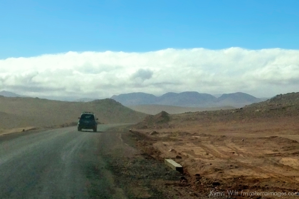 Africa, Morocco, Skoura. Driving toward approaching Sahara sandstorm.