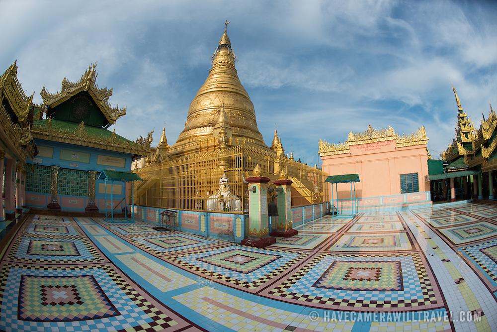 Tiled courtyard at Soon Oo Pon Nya Shin Pagoda. Sitting on top of Nga-pha Hill, Soon Oo Pon Nya Shin Pagoda is one of multiple pagodas and temples in the religious district of Sagaing, near Mandalay. The original pagoda dates to 674.