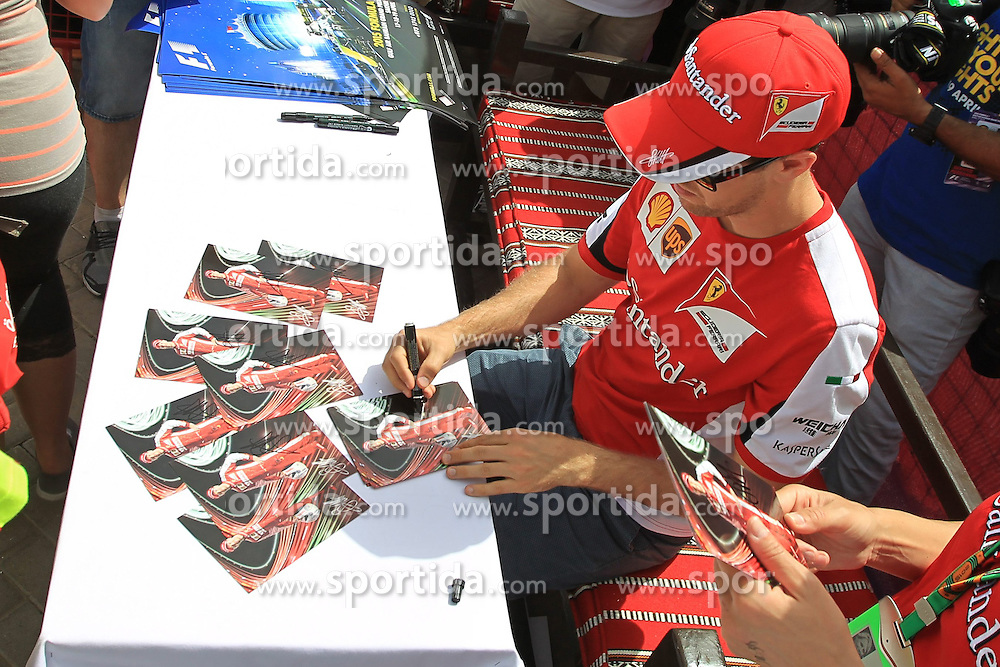 18.04.2015, International Circuit, Sakhir, BHR, FIA, Formel 1, Grand Prix von Bahrain, Qualifying, im Bild Sebastian Vettel (GER) Ferrari signs autographs for the fans // during Qualifying of the FIA Formula One Bahrain Grand Prix at the International Circuit in Sakhir, Bahrain on 2015/04/18. EXPA Pictures &copy; 2015, PhotoCredit: EXPA/ Sutton Images/ Mirko Stange<br /> <br /> *****ATTENTION - for AUT, SLO, CRO, SRB, BIH, MAZ only*****