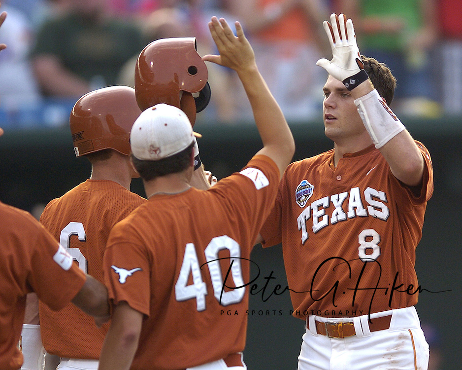 Texas Longhorn David Maroul (8) celebrates with his teammates after hitting a two run homerun in the top of the fourth inning against the Florida Gators.  Texas defeated Florida 4-2 in game one of the Championship Series of the College World Series at Rosenblatt Stadium in Omaha, Nebraska on June 25, 2005.
