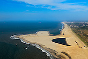 Nederland, Zuid-Holland, Gemeente Westland, 23-05-2011; Delflandse Kust ter hoogte van Ter Heijde en Monster, Scheveningen en Den Haag aan de horizon..Zandmotor, aanleg van kunstmatig schiereiland door het opspuiten van zand voor de kust. Wind, golven en stroming zullen het zand langs de kust verspreiden waardoor breder stranden en duinen ontstaan. De zandmotor is een experiment in het kader van kustonderhoud en kustverdediging. In de achtergrond de kassen van het Westland..Sand Engine, construction of artificial peninsula by the raising of sand for the coast of Ter Heijde (near the Hague, at the horizon). Wind, waves and currents will distribute the sand along the coast yielding wider beaches and dunes along the coastline. The Sand Engine is a experiment for coastal maintenance of coastal defense. In the background the Westland greenhouses..luchtfoto (toeslag); aerial photo (additional fee required).foto Siebe Swart / photo Siebe Swart