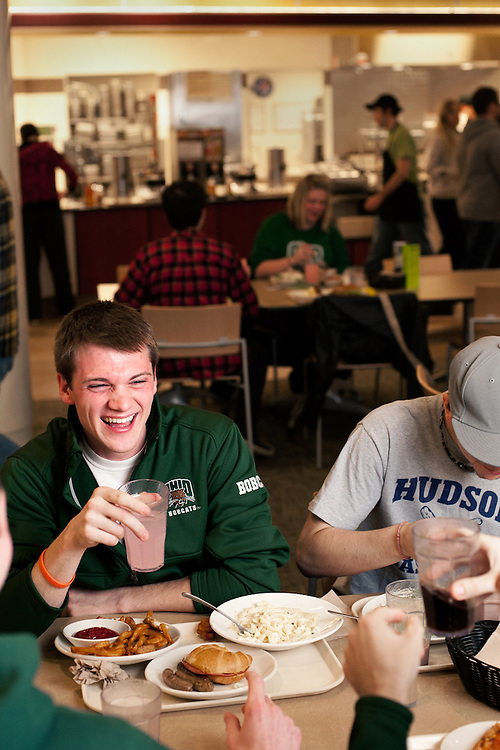 Taylor Henning laughs with friends at Nelson Dining Hall. Photo by: Ross Brinkerhoff. Dining Halls Nelson Facilities Buildings Students
