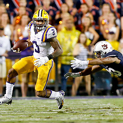 Sep 21, 2013; Baton Rouge, LA, USA; LSU Tigers wide receiver Odell Beckham (3) breaks away from a diving tackle attempt by Auburn Tigers defensive back Mack VanGorder (20) during the second half of a game at Tiger Stadium. LSU defeated Auburn 35-21. Mandatory Credit: Derick E. Hingle-USA TODAY Sports
