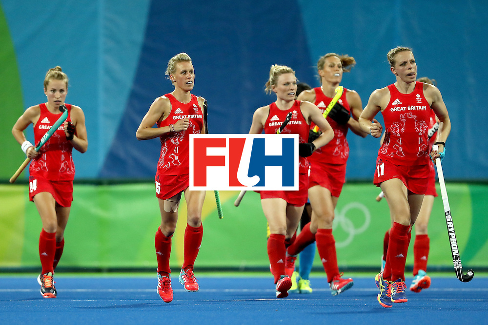 RIO DE JANEIRO, BRAZIL - AUGUST 08:  Shona Mccallin #24, Hollie Webb #20,Kate Richardson-Walsh #11, and Alex Danson #15 of Great Britain run upfield after scoring a goal against India during a Women's Pool B match on Day 3 of the Rio 2016 Olympic Games at the Olympic Hockey Centre on August 8, 2016 in Rio de Janeiro, Brazil.  (Photo by Sean M. Haffey/Getty Images)