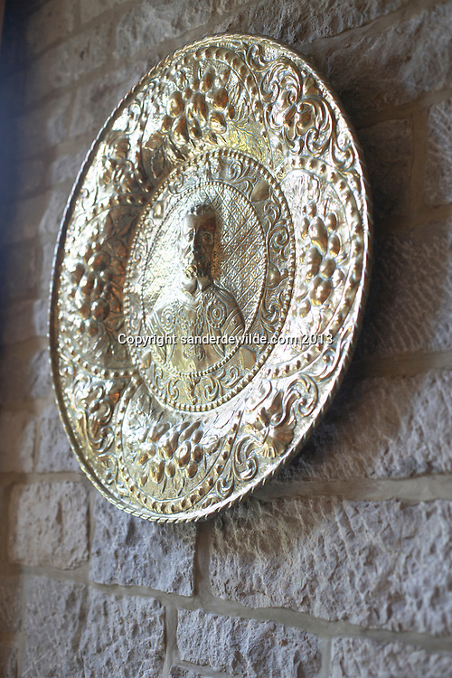 Old plate on wall. Credit Sander de Wilde for The Wall Street Journal.  Castle