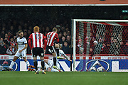 Brentford Midfielder, Lewis Macleod (4) scores a goal to make it 1-1 during the EFL Sky Bet Championship match between Brentford and Middlesbrough at Griffin Park, London, England on 17 March 2018. Picture by Adam Rivers.